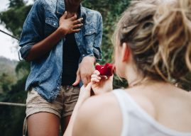 woman-proposing-to-her-happy-girlfriend-outdoors-PN78GTA.jpg